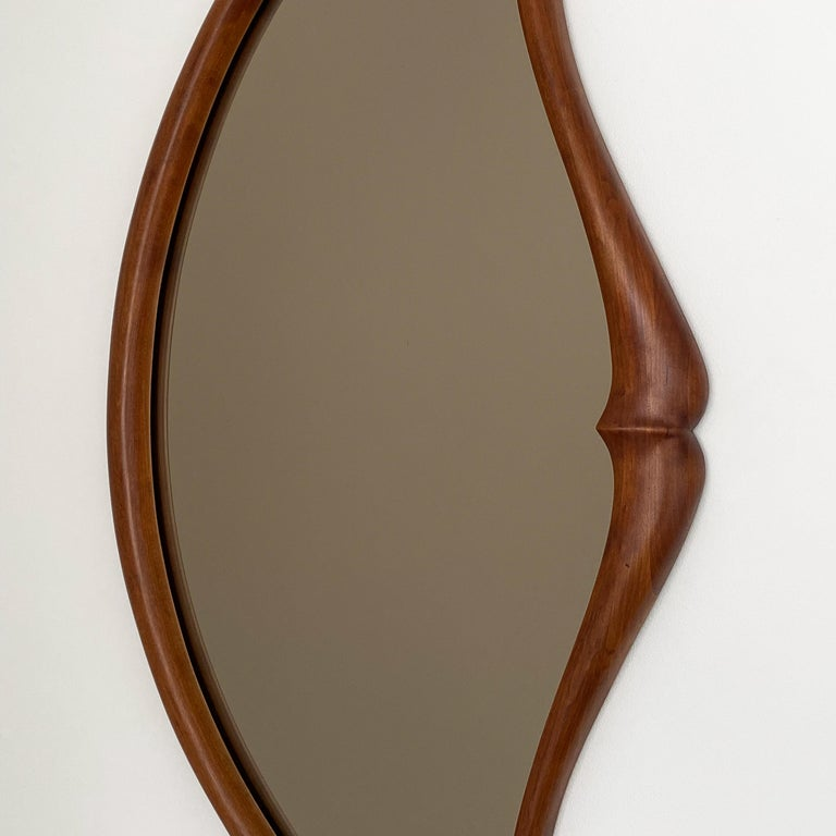 Bronzed Pair of Studio Craft Movement Carved Sculptural Walnut Wall Mirrors, Mark Levin For Sale