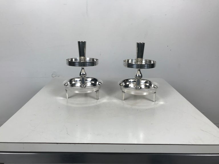 Pair of stylized tiered silver plated candleholders by Tommi Parzinger.