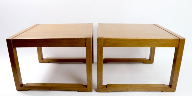Chic pair of Asia modern style end tables designed by Edward Wormley for Dunbar. Tables are in original estate condition and show some surface wear, including visible veneer fracture to top of one Stand, cosmetic not structural ( pictured ). Both