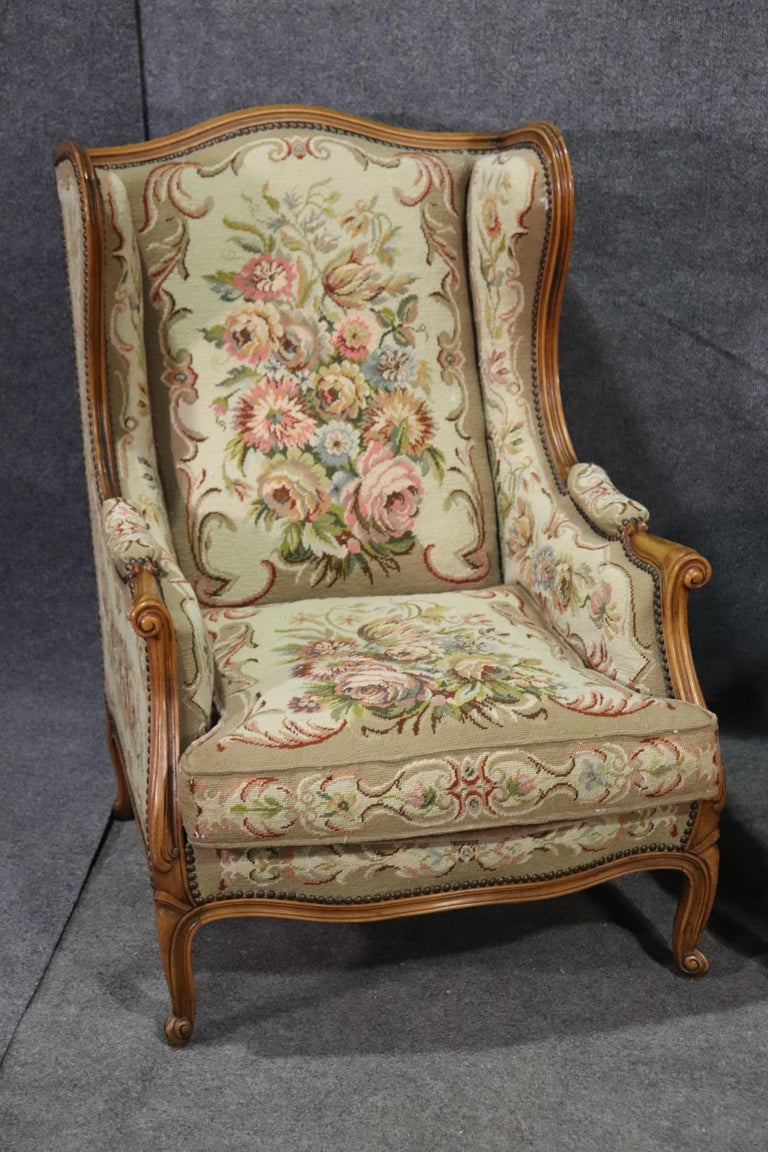 These are beautiful French wingchairs or bergère chairs. The chairs feature tapestry upholstery and walnut frames. The chairs are in good condition for their age. They date to the 1950s era and measure 38 tall x 28 wide x 36 deep and seat height is