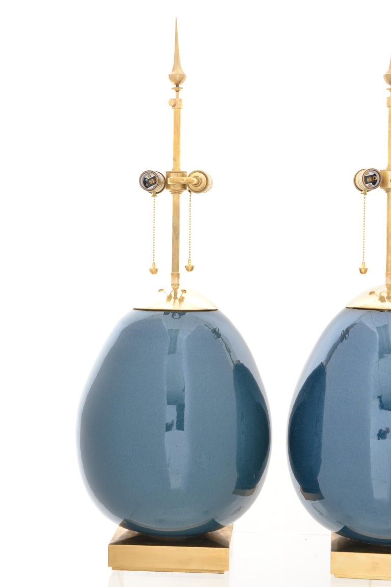 A striking design by noted designer Thomas O'Brien for Visual Comfort & Company Lighting. This pair in a luscious blue with brass fittings. Gently used with no noticeable wear.