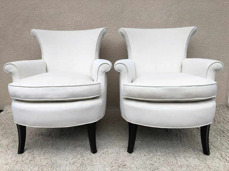 Pair of Tommi Parzinger, for Charek modern petite club/slipper arm chairs , in a off white chenille velvet .Original Down cushions .Nice scale and detail the shape.