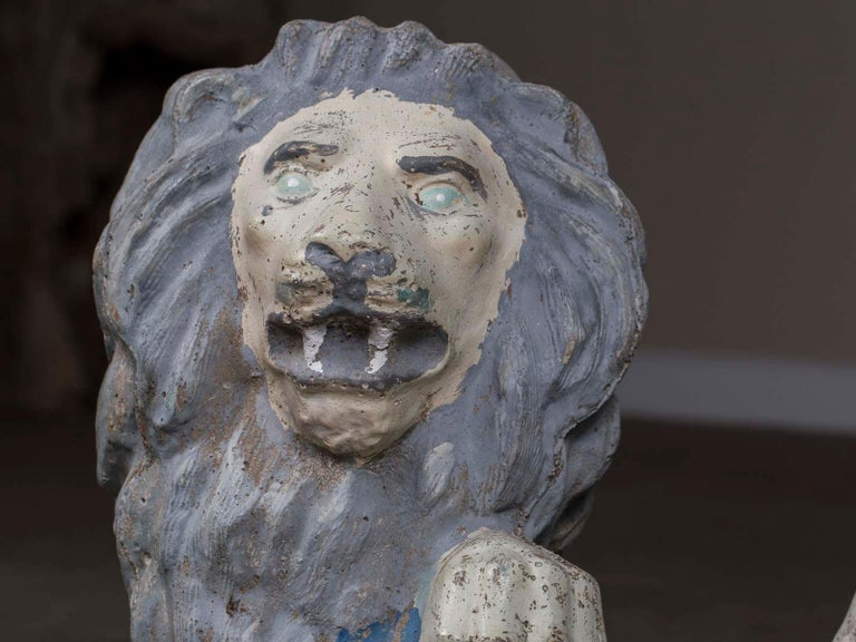 A pair of vintage English French cast stone lion garden ornaments with a painted finish circa 1930. What personality these lads have! Be sure to use the enlarge and zoom functions offered on our website to see the details. Both lions have a
