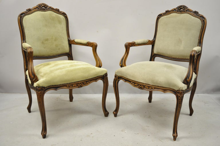 Pair of vintage French Provincial Louis XV style Italian armchairs by Chateau D'ax Spa. Item features solid wood construction, suede leather upholstery, beautiful wood grain, nicely carved details, cabriole legs, quality Italian craftsmanship, circa