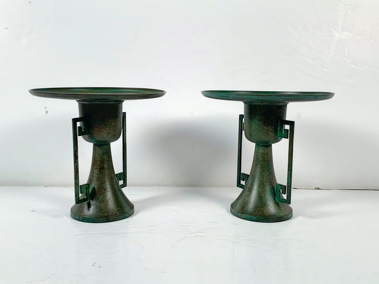 A striking and stylish pair of vintage Japanese cast and patinated bronze usubata, vessels for ikebana flower arranging, early to mid-20th century, Japan.   The pair of tall vessels each in two sections. The vessel of circular form with a deep