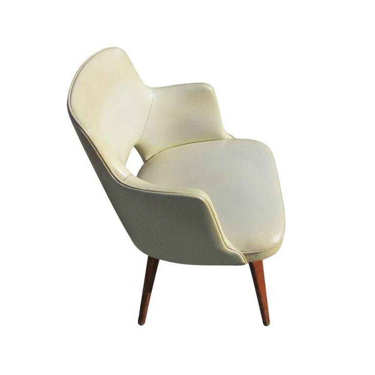 Thonet  Two vintage Thonet armchairs.  Upholstered in white vinyl on wood bases.
