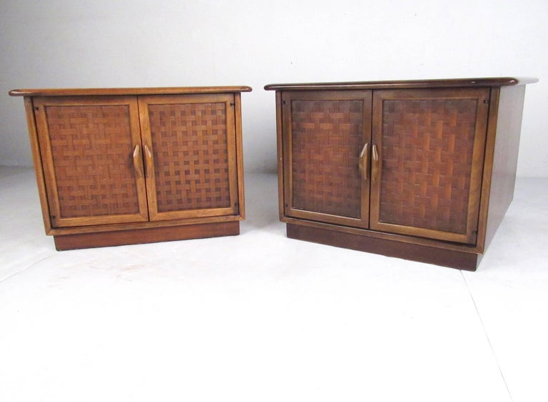 This stylish pair of vintage walnut end tables features basket weave fronts as designed by Warren Church for Lane Furniture. Spacious storage cabinet makes these vintage modern lamp tables with carved door pulls a unique Mid-Century Modern addition