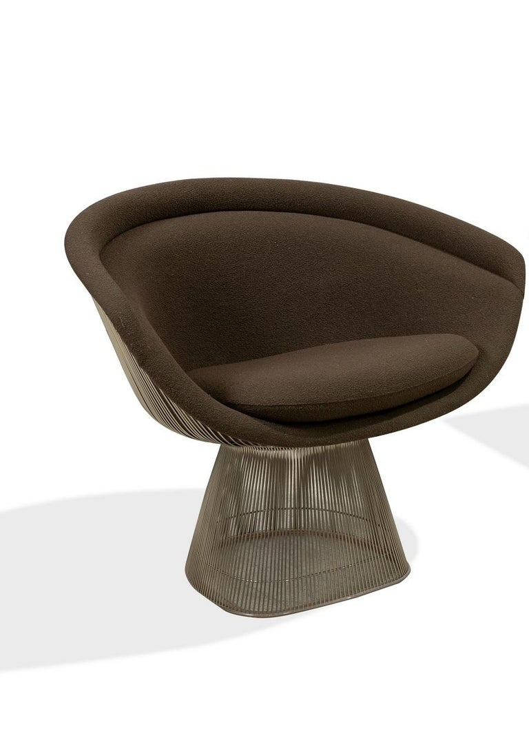 Pair Warren Platner lounge chairs. The chairs have brown upholstery with a nickeled steel frame.