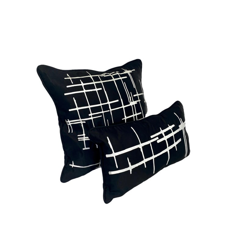 Authentic Italian silk duchesse satin pillows in midnight black. White vinyl print inspired by modern architecture and executed in our in-house design studio in Manhattan. Measures: Large pillow: 20 x 20 in / 51 x 51 cm. Small pillow: 14 x 20 in /