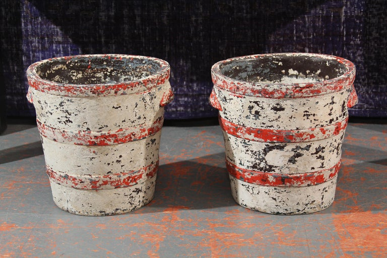 Pair of fiber cement planters by Swiss architect willy guhl. Banded pail shape with two molded handles on each planter. Unusual form and wonderful patina and color. Perfect for indoors or out.