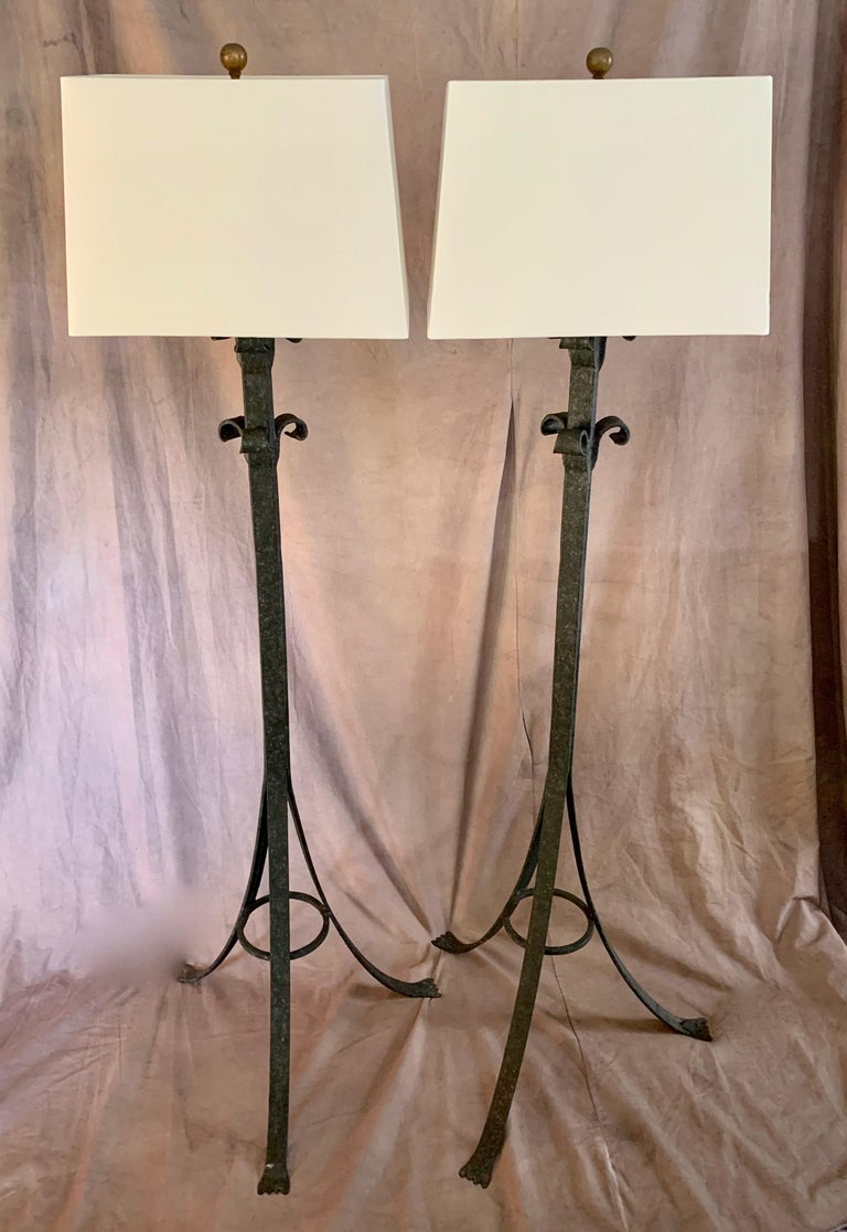 A handsome pair of wrought iron floor lamps - suitable for the living room, den, office or bedroom. A compliment to modern and traditional spaces, especially spaces that lend their tone to Spanish, Moroccan or tribal spaces. Single bulb housing with