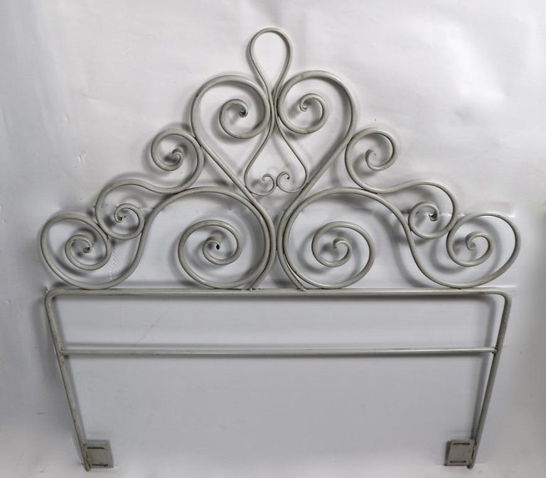 Well crafted pair of   scrollwork wrought iron headboards suitable for twin size beds ( 44 inch total W. ) You can use these as two separate headboards by attaching a Hollywood frame to each, or create one bed / daybed by using one as a headboard