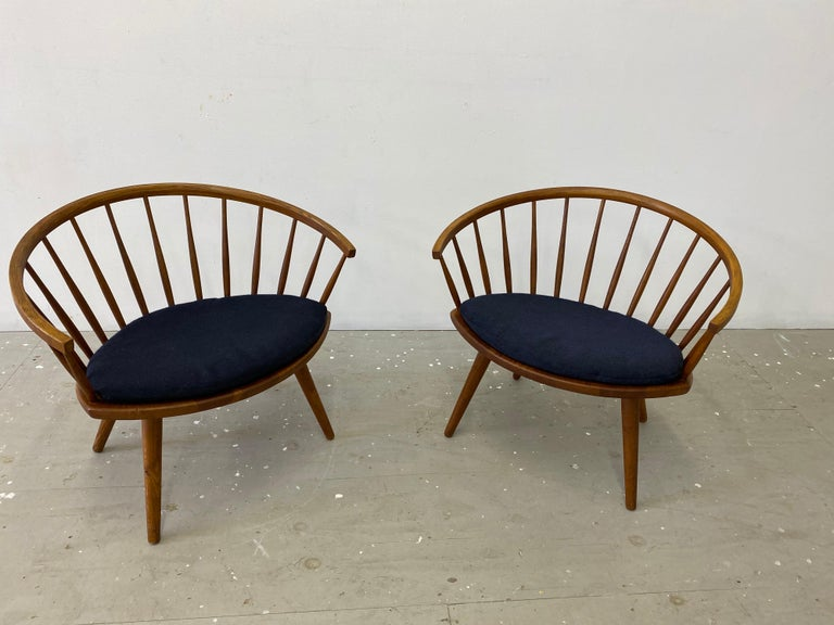 Yngve Ekstrom pair of Arka lounge chairs. Exceptional pair with beautiful Grain throughout! Solid oak construction. All legs screw out for easy shipping! These chairs are solid as a rock! Small seat cushions included as well that look to be