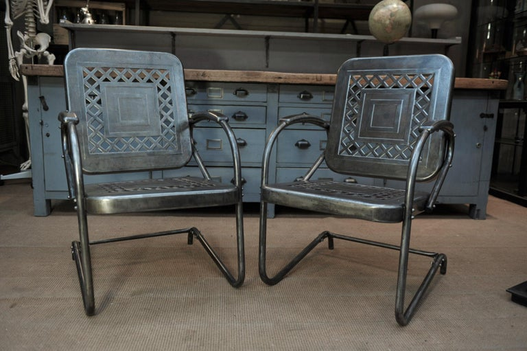 Pair of perforated metal garden armchairs or chairs, 1950s. Polished finish all in very good condition.