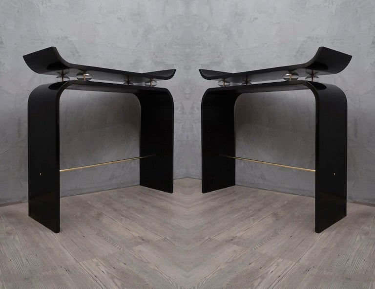 Pair of console tables with captivating shape