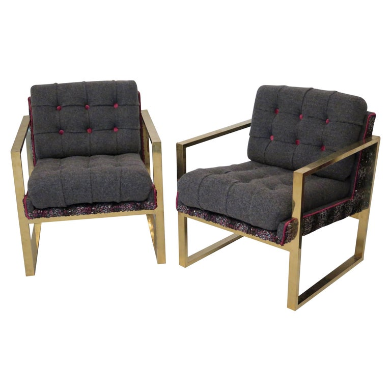 Brass structure and wool fabric, for this pair of armchairs out of the ordinary in the Italian style of Romeo Rega.  Linear and squared the structure of this armchairs, all in polished brass. While the seat and the backrest are in fine fabric. A