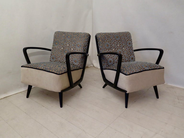 Italian armchairs of 1950s, upholstered in velvet combined and black shellac for the armrests.  This extraordinary pair of 1950s chairs are upholstered with velvet combined by our upholstery atelier. These chairs have a very dynamic look, due to the