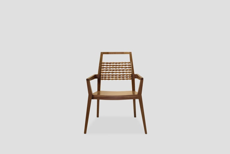 Pakal walnut armchair with beads of Chechén was designed by Beata Nowika for Breuer Estudio. This pice is part of Arquitectura y Ebanistería collection in which Beata collaborated with Breuer to create exceptional pieces. 