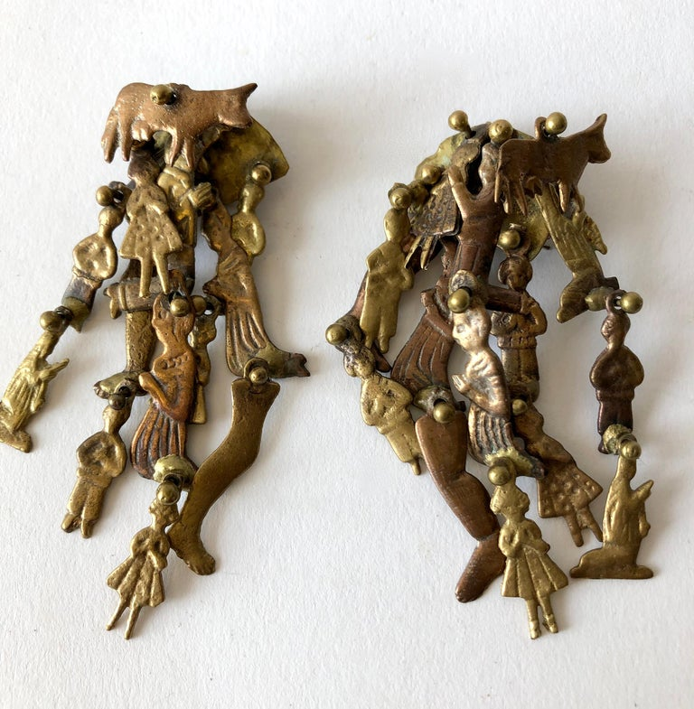 Bronze milagros dangling earrings created by Pal Kepenyes of Acapulco, Mexico.  Earrings measure 3.75