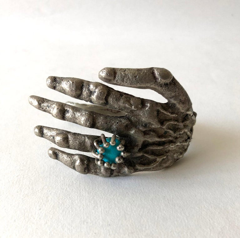 Surrealist bronze hand cuff bracelet with turquoise ring decoration created by Pal Kepenyes of Acapulco, Mexico.  Bracelet measures 2.5