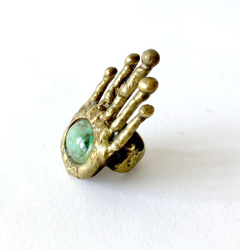 Surrealist bronze with Mexican turquoise accent hand ring by sculptor and jeweler Pal Kepenyes of Acapulco, Mexico.  Ring is a finger size 6.25.  Face of ring measures 2