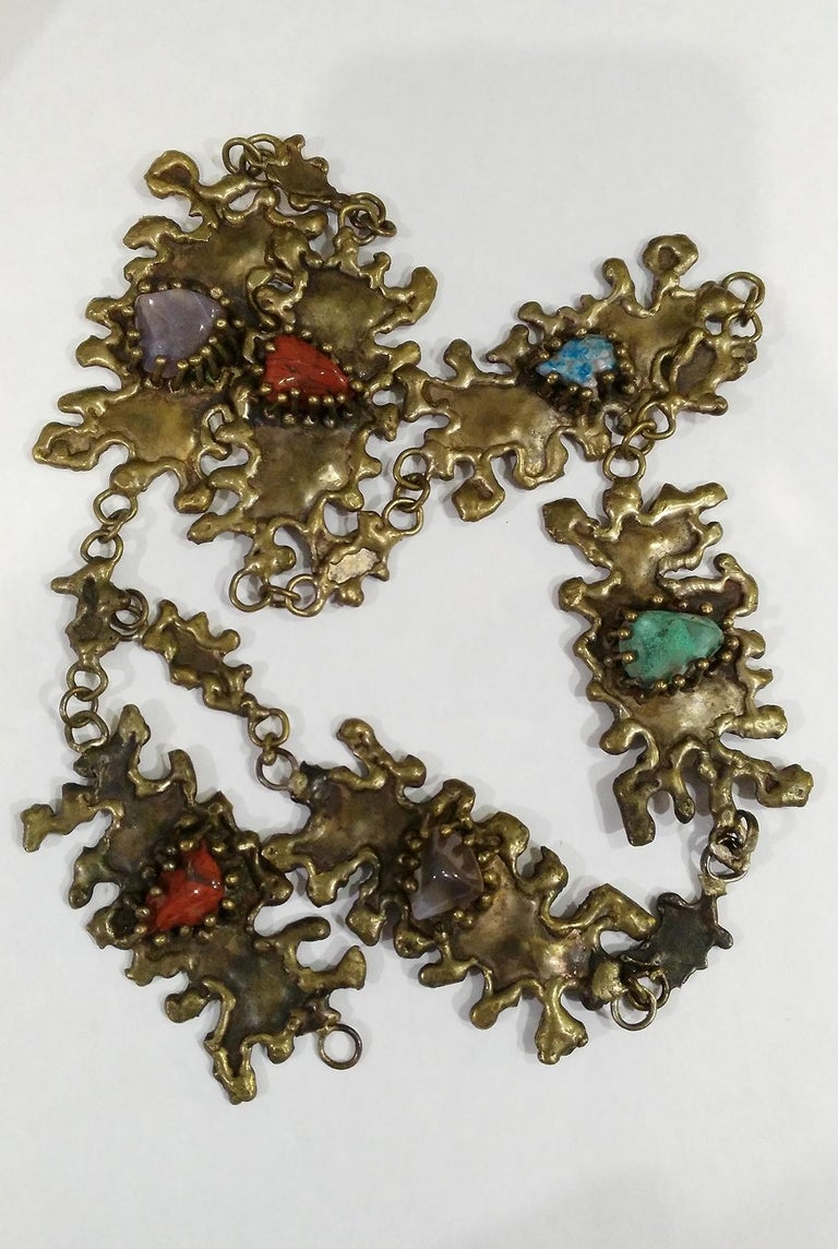 A gorgeous Brutalist bronze necklace with semiprecious stones by Pal Kepenyes. The necklace with 6 organic-shaped medals and 6 irregular semiprecious stones set by needle-shaped claws. Sealed in the back of one of the medals.  A sculptor from