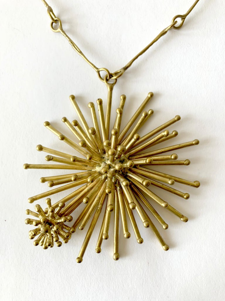 Gold plated bronze starburst necklace created by Pal Kepenyes of Acapulco, Mexico.  Pendant measures 4.75