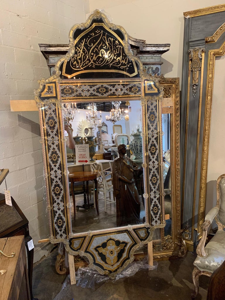 Incredible Venetian reverse painted mirror with enamel beads. The mirror has a very elaborate design and is very large in scale. It makes a very bold statement and is absolutely gorgeous.