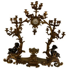 Palatial and Grand Bronze Doré and Patinated French Clock with 26 Candelabrum