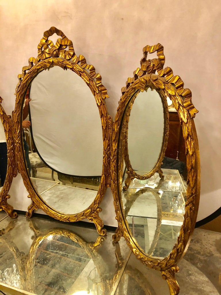 Palatial French Giltwood Triple Oval Shaped Vanity Mirror