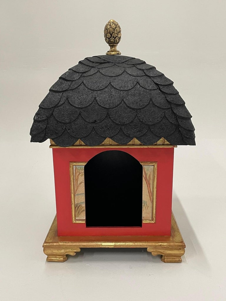 For the dog who has everything, an over the top Hollywood Regency style doghouse in red, black and gold. Lovely pastural scenes are painted on the sides. Opening for lucky puppy; 13 H x 9 W.