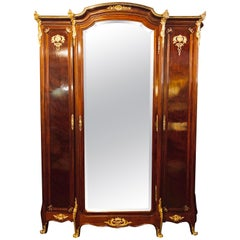 Palatial Louis XV Doré Mounted Three-Section Armoire with Interior Mirrored Door