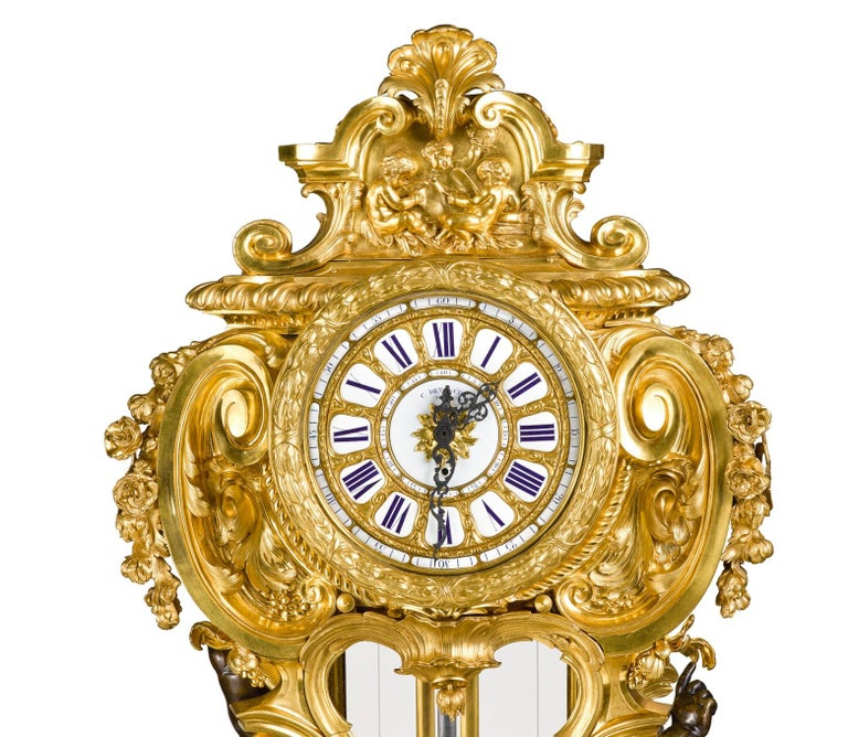 A palatial, extremely rare, and important Napoleon III French ormolu and patinated bronze regulateur de parquet clock, by Louis-Constantin Detouche, Paris, circa 1860.  The clock case made form the finest french ormolu, with 2 very large patinated