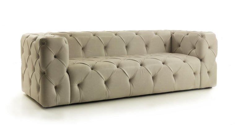 Palatino capitonnè sofa in pearl leather This sofa is covered with leather art. Breva col. 4209 pearl.   Dimensions: 272 W x 95 D x 75 H, SH 46 cm.  This item has been individually handmade by our master craftsmen. Any irregularities or natural