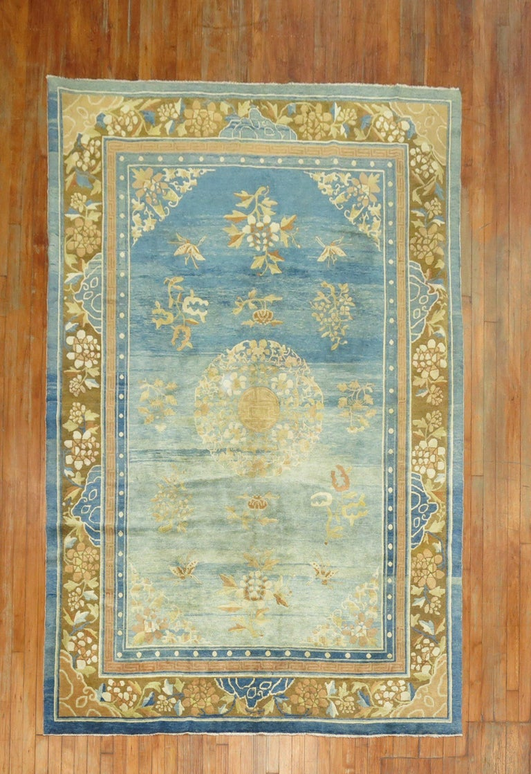 Enchanting early 20th century highly decorative Chinese Peking rug with an abrashed light blue field The wool and feel of the rug is very soft on the feet. It has a silky sheen to it as well.