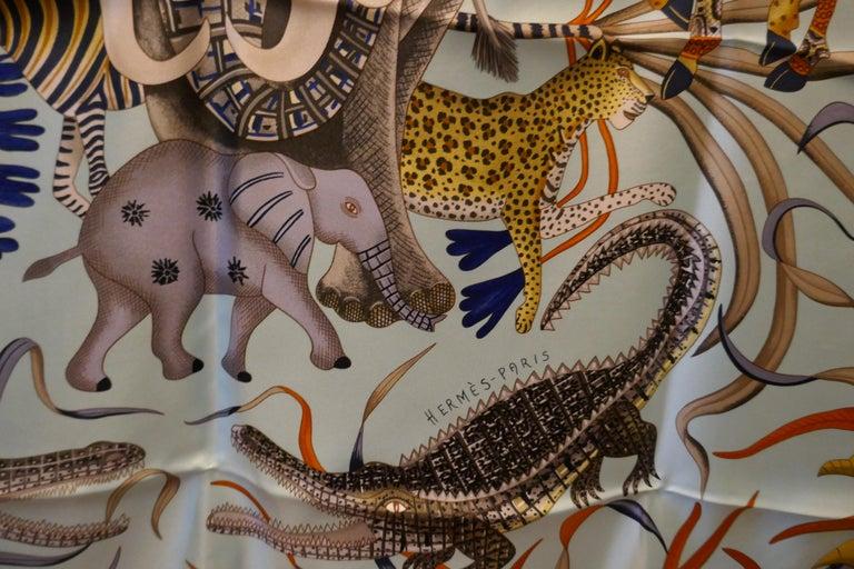 """Pale Blue HERMÈS Ardmore Artists design """"La Marche du Zambeze"""" 100% Silk Scarf,  For Sale 7"""