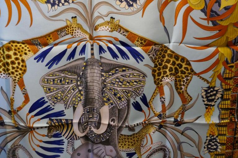 """Pale Blue HERMÈS Ardmore Artists design """"La Marche du Zambeze"""" 100% Silk Scarf,  For Sale 9"""