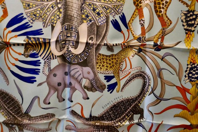 """Pale Blue HERMÈS Ardmore Artists design """"La Marche du Zambeze"""" 100% Silk Scarf,  For Sale 3"""