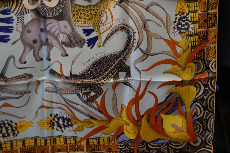 """Pale Blue HERMÈS Ardmore Artists design """"La Marche du Zambeze"""" 100% Silk Scarf,  For Sale 4"""