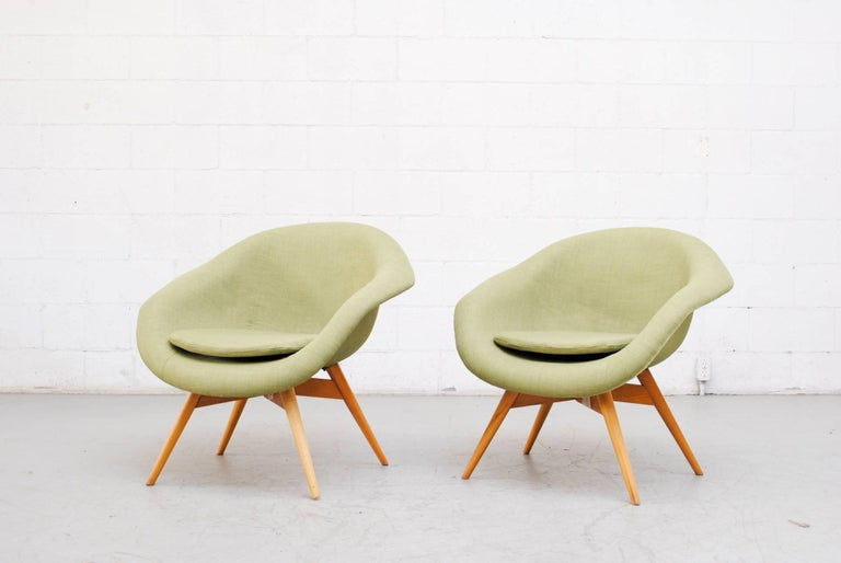 Newly upholstered pale green bucket chairs by Miroslav Navratil. Frames are in good original condition with visible wear to frame. Others available in assorted color colors. (Two available).