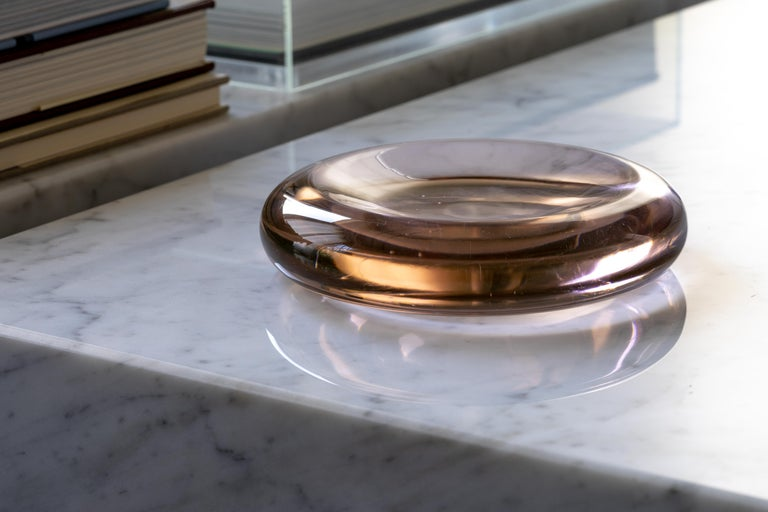 A lovely pale pink or blush-colored blown glass dish by Salviati & Co. from the 1970s. Typical of American designer Charles Pfister's work with the Murano-based firm, the smooth, polished dish resembles an oversized lozenge that appears to glow from
