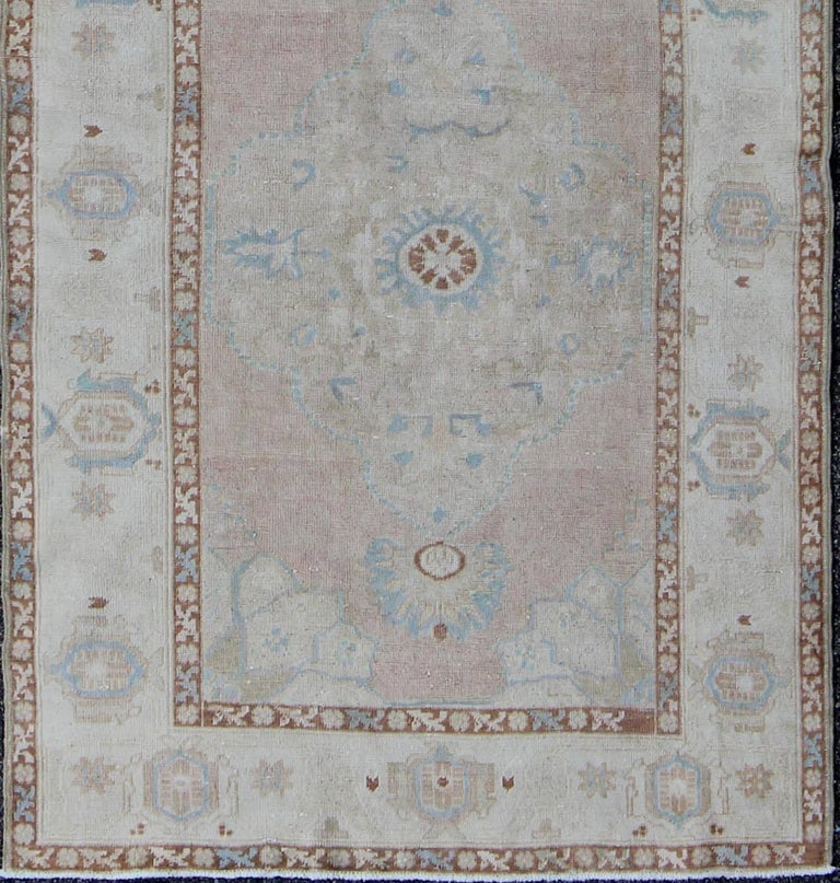 Pale pink, teal and ivory vintage Turkish Oushak runner with three medallions, rug na-63085, country of origin / type: Turkey / Oushak, circa 1930  This beautiful vintage Oushak runner from early 20th century Turkey features a classic Oushak