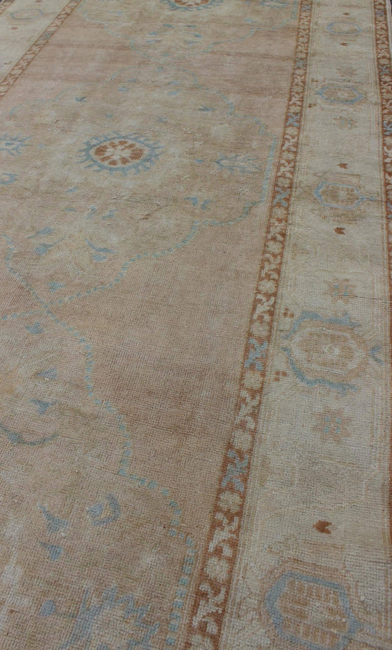 Mid-20th Century Pale Pink, Light Blue and Ivory Vintage Turkish Oushak Runner For Sale