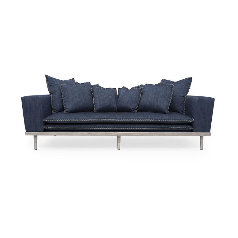 The Palisades sofa is the perfect combination of relaxed coastal living and sophisticated design. With a wood frame composed of hand-lacquered natural finished wood, this arm chair boasts clean lines, ease, coastal style, and comfort at the heart of