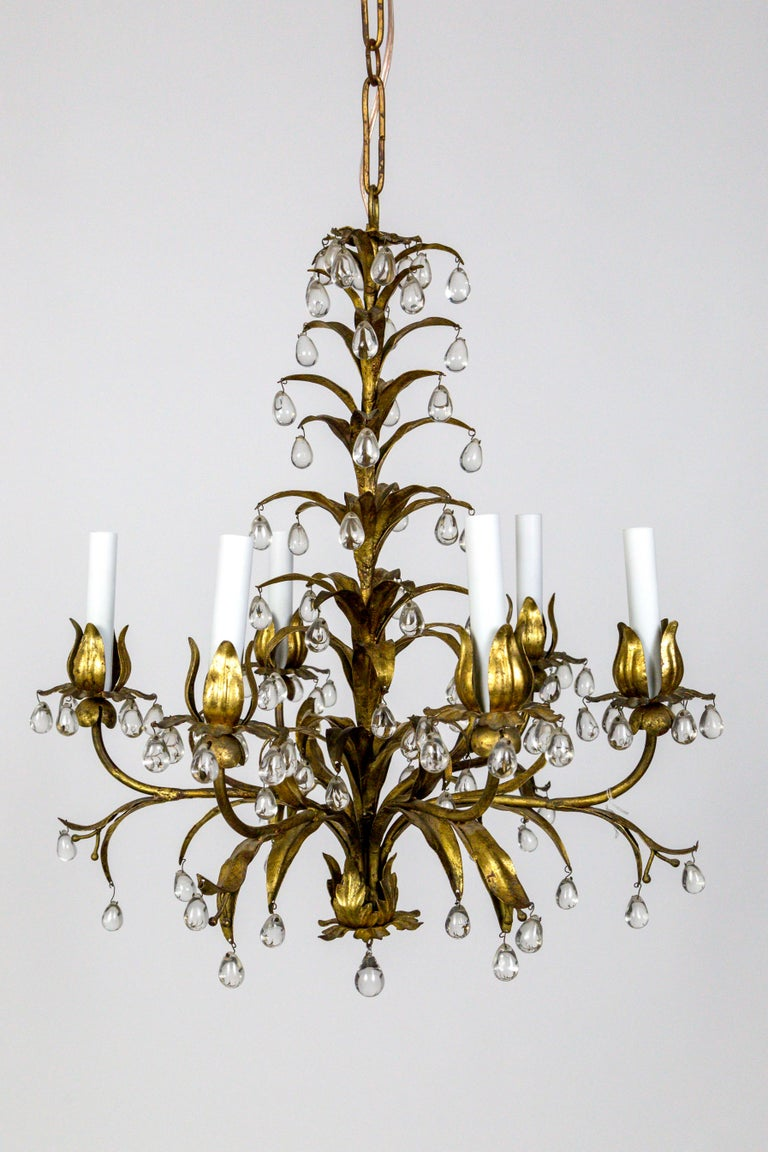 A whimsical, tole leaf and grape crystal, 6-light chandelier in Palm Beach Style - late Hollywood Regency. A truly gorgeous fixture with pretty seed and stem details, and crystals that look like gigantic raindrops that reflect small pictures of its