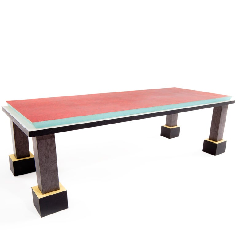 The Palm Springs dining table, in briar and plastic laminate was originally designed in 1984, by Ettore Sottsass for Memphis Milano.   Ettore Sottsass was born in Innsbruck in 1917. In 1939 he graduated in architecture at the Politecnico di Torino.