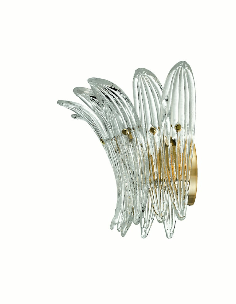 The Palmette 5310 is a series of striking lighting units based on sectional elements that can be assembled to make anything from simple domestic wall sconce to large hanging lamps for most distinguished spaces. It comes only in clear crystal with