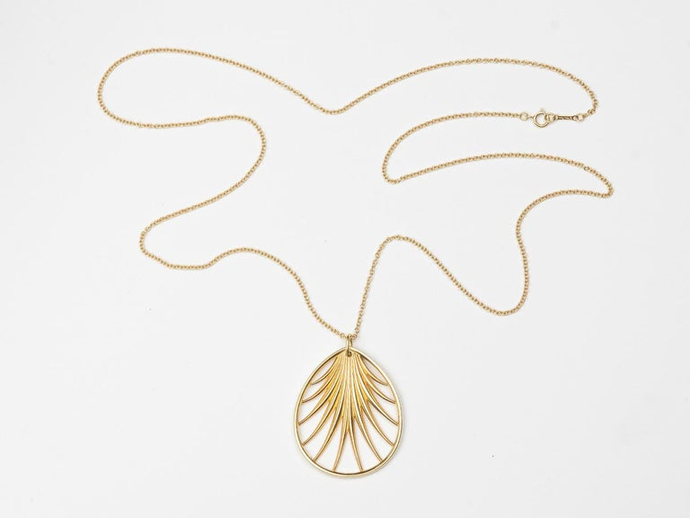18k gold  16 inch chain suspending a stylized palm frond. Signed PALOMA  PICASSO TIFFANY & CO. 750 AU ITALY.