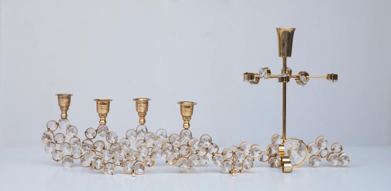 Five beautiful candleholders in the Hollywood Regency style, manufactured in the 1970s by Palwa Germany. Made of gold-plated brass with faceted crystals in excellent vintage condition.  Measures: 23 H x 9 B x 5 D cm  19 H x 18 B x 12 D cm  12