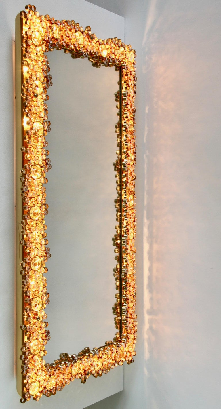 Stunning & large rectangular Mid-Century gilt brass and crystal wall-mounted backlit vanity or hallway mirror by Palwa, Germany, circa 1965-1975. Perfect for the Hollywood Regency style, there is no better combination than gold and crystal for the